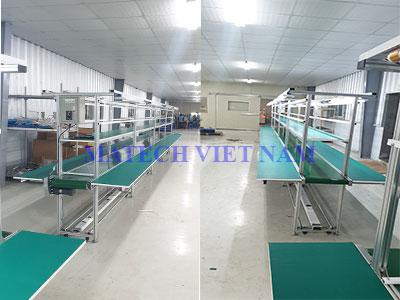 Băng tải PVC khung nhôm định hình có mặt bàn phụ dài 8m